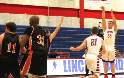 Lincoln Land's Ryan Below (33) shoots a jumper in a game against Greenville College's junior varsity team.