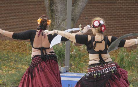 Jordan Minder/The Lamp Belly dancers perform during Lincoln Land's 11th annual Multicultural Festival on Wednesday, Oct. 1, 2014. Vendors and performers filled the sidewalks outside A.Lincoln Commons, offering students a chance to learn about cultural opportunities.