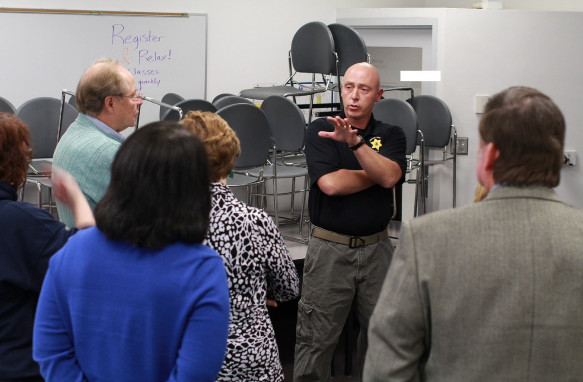 Police Chief teaches participants about how to respond to an active shooter