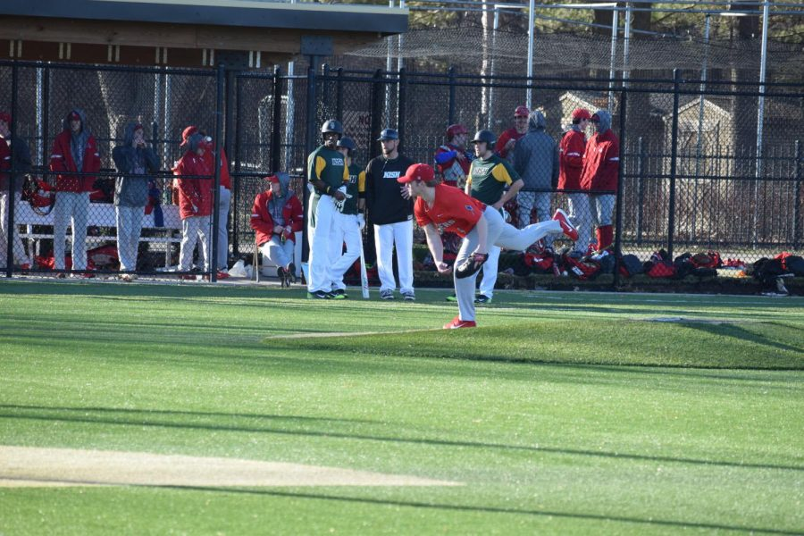 Shayne+McNally+throws+a+pitch+in+the+Feb.+25+game+agaainst+Kishwaukee+College.