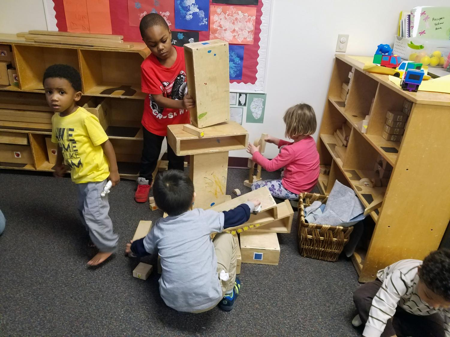 Children build with blocks together in the LLCC Child Development Center.