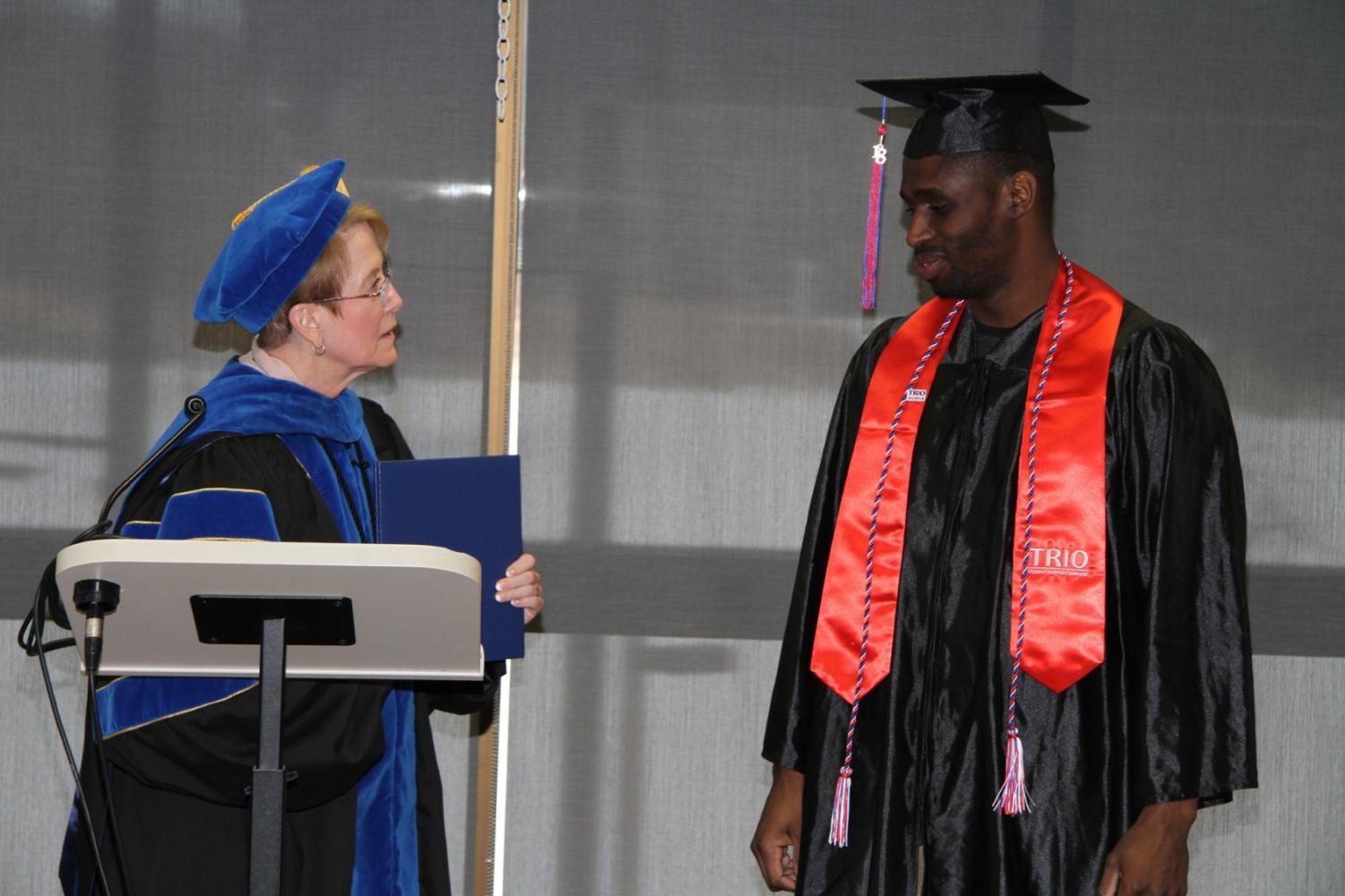 President Charlotte Warren prepares to hand Fall 2018 LLCC graduate his diploma in the R.H. Stephens Room on Jan. 16. Campbell is deploying to the Middle East with the Air National Guard, so he won't be able to attend graduation in May. The college held an impromptu ceremony to award his diploma and honor his achievement.