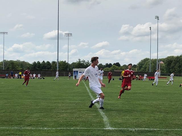 Jack Madin running down the feild during Loggers vs. Scott Community College.