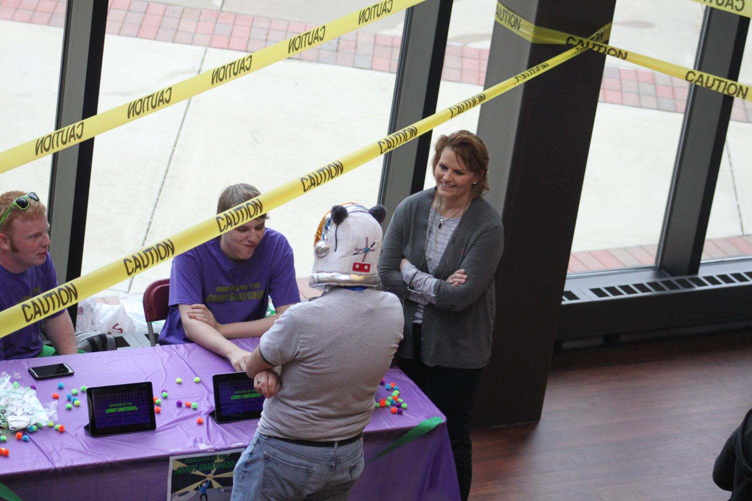 Hyler Pence and Brinton Johnson sit at the table and show off a game they created during  the EndGame Expo, previously called the Video Game Design Tournament, in the A.Lincoln Commons on Thursday, April 25, 2019. The expo hosted teams and the video games they have created in Video Game Design I and Video Game Design II classes.