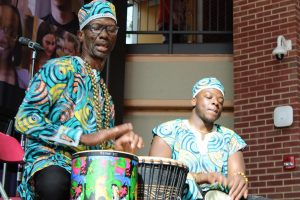 This photo taken by former Lamp Editor Regina Ivy won honorable mention for news photo in the Illinois Community College Journalism Association's annual excellence in journalism contest on April 8, 2021. Roosevelt Pratt and the African Drum Dance Ensemble performed in the A. Lincoln Commons Feb. 3, 2020.