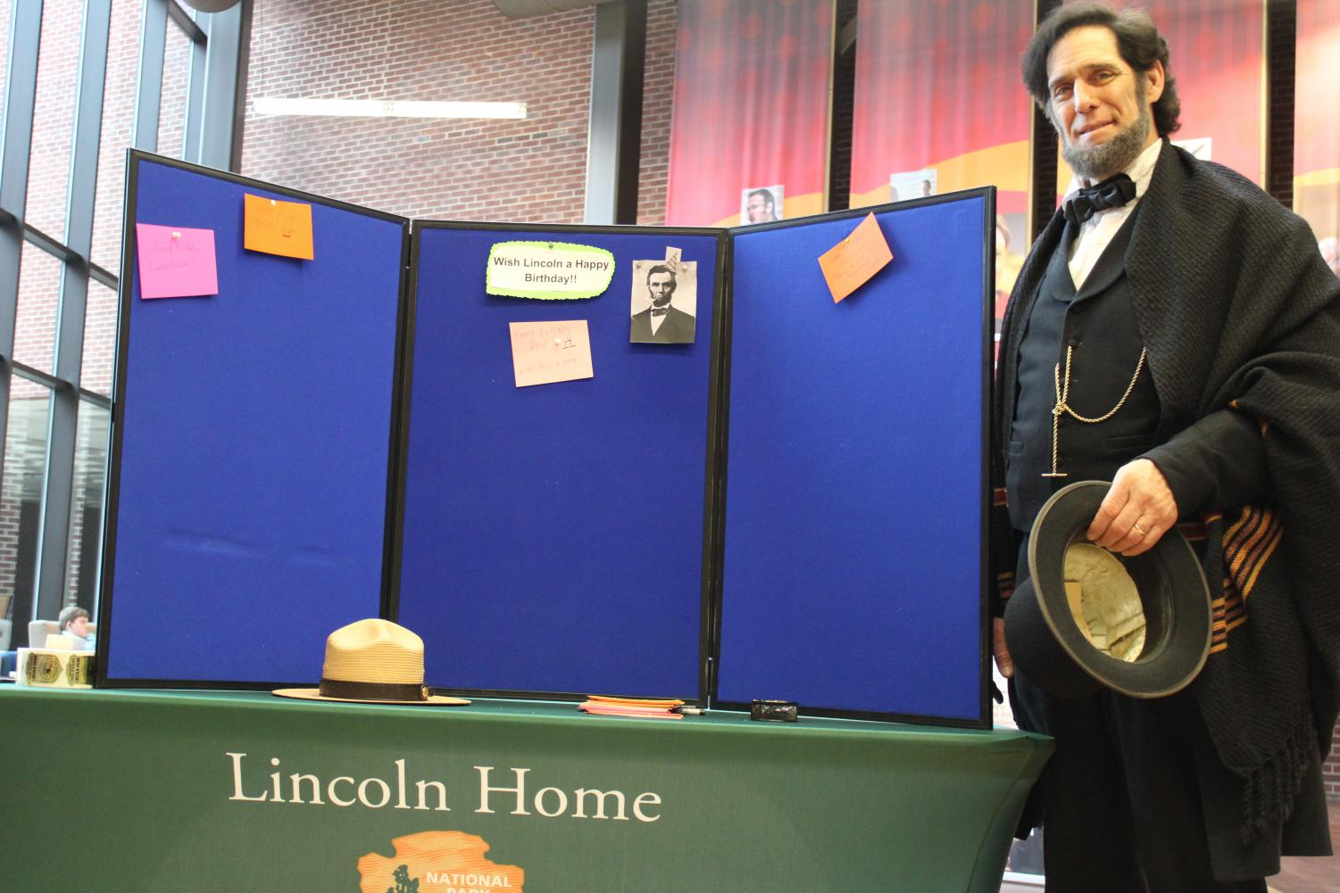 The Illinois Freedom Project is a traveling exhibit that has made its way to LLCC. The Lincoln exhibit aims to share historical stories about freedom from people , places, and events in Illinois. Lincoln, in this photo, is celebrating his birthday with the students of LLCC