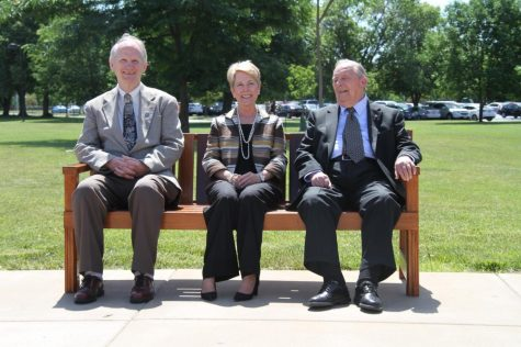 Dr. John Roberts poses with President Charlotte Warren and former LLCC President Robert Poorman on June 4, 2018, when the bench was dedicated to honor Doc Roberts 48-year teaching career. The bench has been removed and sent for repairs because of weather-related deterioration.